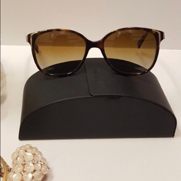 9bf941d77e21 Polarized Prada Sunglasses. M 5ae78f94daa8f6664b67ccf3. Other Accessories  ...